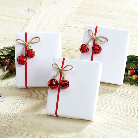 This Rustic Christmas wrapping idea couldn't be easier, just buy the jingle  bell tie-ons, and wrap in your favourite plain kraft paper. Simple and  elegant!