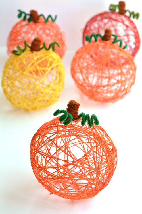 Easy Pumpkin Craft ideas on AllThingsChristmas.com - Yarn Pumpkins